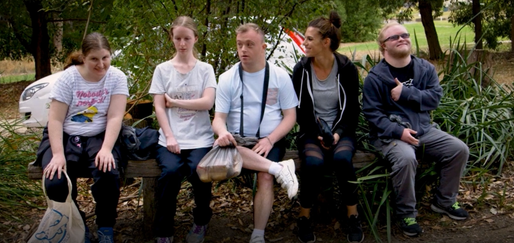Group of people sitting on a park bench